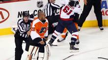 Philadelphia Flyers goalie Ray Emery, left, escaped punishment after last weekend's brawl against the Blue Jackets (TOM MIHALEK/The Associated Press)