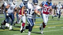 Toronto Argonauts' quarterback Zach Collaros runs in for a touchdown during second half CFL action against the Montreal Alouettes in Montreal, Sunday, September 8, 2013. (Graham Hughes/THE CANADIAN PRESS)