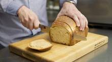 Mark Schatzker prepares a loaf of home made bread at his home in Toronto, Ontario, Friday April 18, 2014. (Kevin Van Paassen For The Globe and Mail)