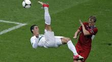 Portugal's Cristiano Ronaldo performs a bicycle kick past Czech Republic's David Limbersky during the Euro 2012 soccer championship quarterfinal match between Czech Republic and Portugal in Warsaw, Poland, Thursday, June 21, 2012. (Gero Breloer/AP)