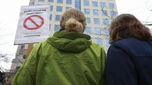 Two women stand in front of BC Hydro headquarters as they protest BC Hydro's use of smart meters in Vancouver, BC, Feb. 29, 2012. (Jeff Vinnick for the Globe and Mail/Jeff Vinnick for the Globe and Mail)
