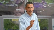 US President Barack Obama speaks about the oil spill following the BP Deepwater Horizon accident during a briefing with officials at the Tarmac Field House at Louis Armstrong New Orleans International Airport in New Orleans, Louisiana, June 4, 2010. (SAUL LOEB/AFP/Getty Images)