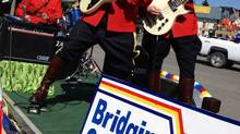 RCMP officers Const. Doug Sokoloski on the guitar, centre, Const. Forrest Anderson on the bass, right, and Const. Jason Fichtner on drums participate in a parade in Pincher Creek, Alta., in the summer of 2012 in this undated handout photo. (HO/THE CANADIAN PRESS)