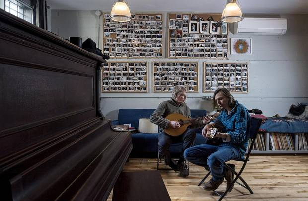 Musicians Joel Plaskett, right, and his father Bill play music from their new record in Plaskett's recording studio The New Scotland Yard in Halifax on Tuesday, Jan. 17, 2017.