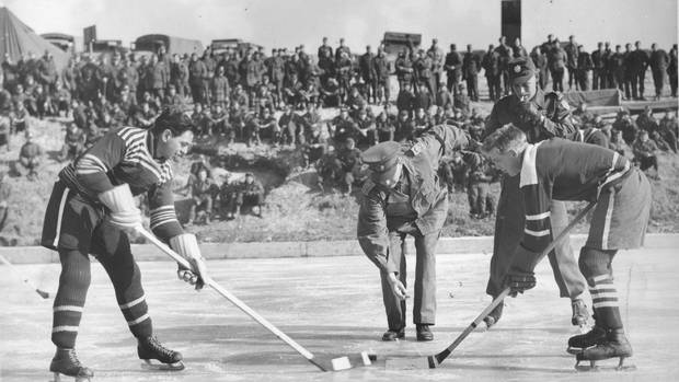 Players face off during a hockey game on the Imjin River in Korea, in January, 1952.