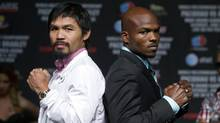 Boxer and Filipino congressman Manny Pacquiao and U.S. boxer Timothy Bradley Jr. pose during a news conference at the MGM Grand Hotel and Casino in Las Vegas, Nevada June 6, 2012. (STEVE MARCUS/REUTERS)