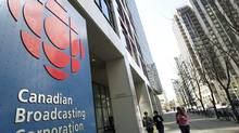 People walk into the CBC building in Toronto on Wednesday, April 4, 2012. (Nathan Denette/CANADIAN PRESS)
