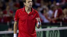 Canada's Daniel Nestor celebrates a point against Italy's Daniele Bracciali and Fabio Fognini during doubles match play at the second round of the Davis Cup tournament in Vancouver, British Columbia April 6, 2013. (BEN NELMS/REUTERS)