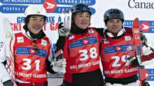 Gold medallist Pavel Krotov of Russia, flanked by silver medalist Canadian Olivier Rochon, right, of Gatineau, Que. and bronze medallist Naoya Tabara of Japan celebrate on the podium at the men's aerials World Cup freestyle event Sunday, January 15, 2012 at Mont-Gabriel in Sainte-Adele, Que. THE CANADIAN PRESS/Jacques Boissinot (Jacques Boissinot/CP)
