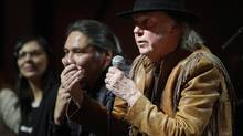 "Singer Neil Young, right, makes a point as he speaks during a news conference before the last concert in his ""Honour the Treaties"" tour in Calgary, Sunday, Jan. 19, 2014. (Jeff McIntosh/THE CANADIAN PRESS)"