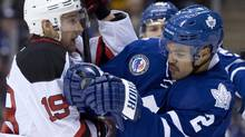 Toronto Maple Leafs defenceman Mark Fraser, right, scuffles with New Jersey Devils centre Travis Zajac during first period NHL action in Toronto on Friday, Nov. 8, 2013. (FRANK GUNN/THE CANADIAN PRESS)