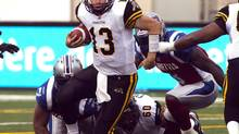 Hamilton Tigercats quarterback Dan LeFevour scrambles from the pocket during first quarter Canadian Football League pre-season action against the Montreal Alouettes Thursday, June 13, 2013 in Montreal. (Ryan Remiorz/THE CANADIAN PRESS)