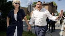 Coalition Avenir Québec Leader François Legault walks with his wife Isabelle Brais during an election campaign stop in Sainte-Anne-de-Bellevue, Que., on Aug. 8, 2012. (Graham Hughes/THE CANADIAN PRESS)