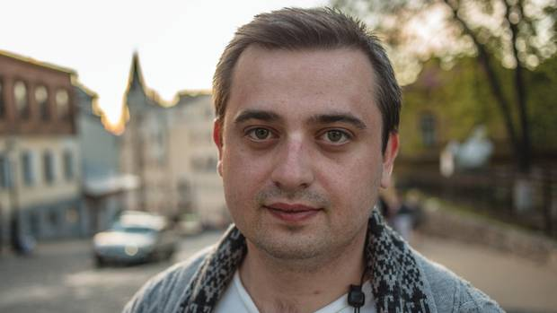 'Dear Russians,' anti-separatist Vladimir Simperovich, above, wrote early in the conflict. 'Please do not tell me what's going on Donetsk. I am in Donetsk.'