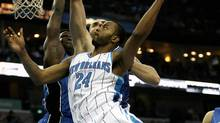 New Orleans Hornets guard Morris Peterson (24) shoots over Orlando Magic defenders Marcin Gortat and Mickael Pietrus, during the first half of their NBA basketball game in New Orleans, Friday, Feb. 26, 2010. (AP Photo/Sean Gardner) (Sean Gardner)