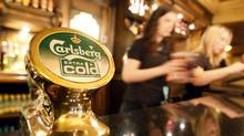 Danish brewer Carlsberg is buying the 15 per cent of Russia's Baltika that it does not already own in a $1.2-billion deal. (Toby Melville/Reuters/Toby Melville/Reuters)