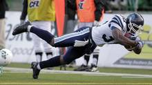 Toronto Argonauts slotback Andre Durie jumps in the end zone for at touchdown while playing against the Saskatchewan Roughriders during first half of the CFL football game in Regina, Saskatchewan October 27, 2012. (DAVID STOBBE/REUTERS)