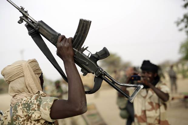 A Chadian soldier raises his automatic weapon to have his picture taken by another soldier in the Nigerian city of Damasak on March 18, 2015, after the joint Chadian-Nigerian force flushed out Boko Haram militants. Combating Islamic extremism has overtaken all other priorities in Donald Trump's foreign policy in Africa.