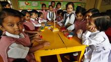 Young Indian children play in a classroom at a school in Lucknow, India, on Oct. 31, 2011. (Rajesh Kumar Singh/Rajesh Kumar Singh/Associated Press)