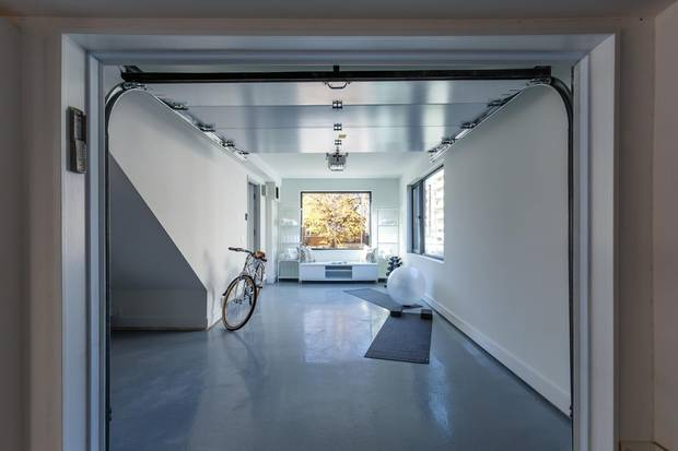 The garages are designed to be read as normal rooms to passersby.