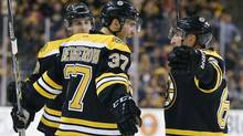 Boston Bruins' Patrice Bergeron celebrates his goal with teammates Brad Marchand, right, and Matt Bartkowski during the second period of an NHL hockey game against the Buffalo Sabres in Boston, Saturday, April 12, 2014. (Associated Press)