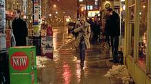 Amanda Seyfried, the titular character in Atom Egoyan's Chloe, walks down College Street in Toronto, where the film is set. (E1 Entertainment)