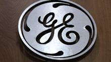 In this Thursday, Jan. 16, 2014, photo, a General Electric logo is displayed on a kitchen appliances in a H.H. Gregg store in Cranberry Township, Pa. (Gene J. Puskar/AP Photo)