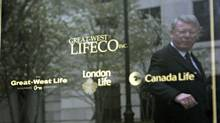 Great-West Life chairman Raymond McFeetors is reflected in a sign after the annual meeting in 2006. (NATHAN DENETTE/THE CANADIAN PRESS)