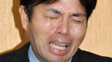 In this Tuesday, July 1, 2014 photo, Hyogo Prefectural assemblyman Ryutaro Nonomura cries during a press conference in Kobe, western Japan. (KYODO NEWS/AP)