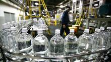 Toronto, November 20 2009 Plastic bottles filled with soda prior to be labelled are carried on conveyor belt at the soft drink maker Cott's bottling plant near Pearson Airport, Toronto. (Fernando Morales/Fernando Morales/The Globe and Mail)