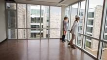 Brescia University College students Amanda Cox, right, and Chelsea Rose tour one of the common areas of the new residence building which is still under construction in London, Ont. (GEOFF ROBINS/The Globe and Mail)