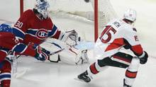 Ottawa Senators' Zach Smith scores on Montreal Canadiens' goalie Peter Budaj during first period NHL playoff action in Montreal on Thursday May 9, 2013. (Ryan Remiorz/THE CANADIAN PRESS)