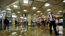 Water covers the floor at Union Station after heavy rains caused flooding in the subway station in Toronto on Friday, June 1, 2012. (Aaron Vincent Elkaim/Aaron Vincent Elkaim / The Canadian Press)