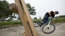 Israel Ramirez tests out Sunnyside Bike Park, Toronto's first large scale city-sanctioned bike park. (Matthew Sherwood for The Globe and Mail)