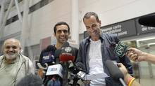 Dr. Mahmoud Loubani (left) beams after his son Dr. Tarek Loubani (centre) and John Greyson returned to Canada after being imprisoned in Egypt for over a month. (Fred Lum/The Globe and Mail)