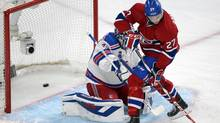 Montreal Canadiens' Alex Galchenyuk scores on New York Rangers goalie Henrik Lundqvist during first period in game five of the NHL Eastern Conference final Stanley Cup playoff action Tuesday, May 27, 2014 in Montreal. (Ryan Remiorz/THE CANADIAN PRESS)