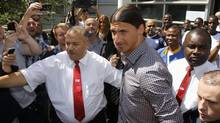 Sweden soccer player Zlatan Ibrahimovic, surrounded by security guards, leaves the Pitie-Salpetriere hospital after his medical examination in Paris July 18, 2012. (BENOIT TESSIER/Reuters)