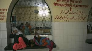 Expectant women wait inside a women's hospital in Allahabad, India: With its booming economy, India still suffers more than 135,000 maternal deaths every year.