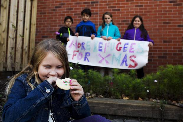 Fiona, 9, and her fellow students are selling baked goods to raise funds for refugees in Toronto.