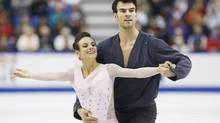 Meagan Duhamel and Eric Radford of Canada skate during their pairs short program at the Skate Canada International figure skating competition in Saint John, N.B., October 25, 2013. (MARK BLINCH/REUTERS)