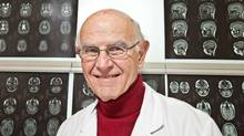 Dr. Charles Tator is seen with MRI brain scans at Toronto Western Hospital on February 6, 2011. (JENNIFER ROBERTS/JENNIFER ROBERTS FOR THE GLOBE AND MAIL)