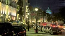Old Montreal's De la Commune Street at night, with the dome of Bonsecours Market in the distance. (Le photographe masqué/www.old.montreal.qc.ca)