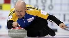 Alberta skip Kevin Koe makes a shot during a morning draw against New Brunswick at the Tim Hortons Brier in Saskatoon, March, 4, 2012. (Jonathan Hayward/The Canadian Press/Jonathan Hayward/The Canadian Press)