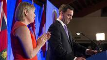Ontario PC Leader Tim Hudak (right) stands with his wife Deb Hutton as he gives his concession speech at his election night party in Grimsby, Ontario on Thursday June 12, 2014. (Chris Young/THE CANADIAN PRESS)