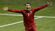 Portugal's Cristiano Ronaldo celebrates after scoring during the World Cup 2014 qualifying playoff second leg soccer match between Sweden and Portugal at Friends Arena in Stockholm, Tuesday, Nov. 19, 2013. (Associated Press)
