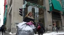 A shopper leaves the Simons department store in downtown Montreal (Christinne Muschi/Christinne Muschi/The Globe and)