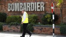 A worker walks past the entrance to the Bombardier plant in Derby, central England, July 5, 2011. (DARREN STAPLES/REUTERS)