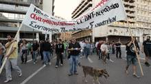 Protesters take part in an anti-austerity rally in Athens on May 22. (YORGOS KARAHALIS/YORGOS KARAHALIS/REUTERS)