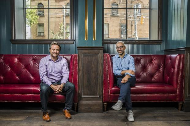 Restaurateurs Erik Joyal, left, and John Sinopoli pose for a picture at the Broadview Hotel on Wednesday, where they are launching three restaurants. The top-floor one is drawing in big crowds.