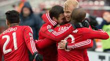 Toronto FC forward Robert Earnshaw (10) celebrates his goal with Toronto FC midfielder Bobby Convey (15) and Toronto FC midfielder Kyle Bekker (8) during the first half in a game against the Montreal Impact at BMO Field. (Nick Turchiaro/USA Today Sports)